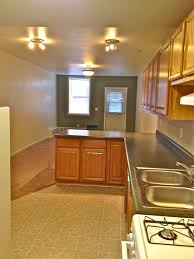 l shaped kitchen designs with brown cabinetry also drawers and