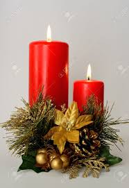 two red candles with white and gold christmas ornament stock photo