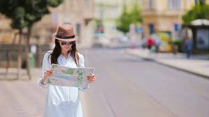 tourist with a city map searching attraction outdoors