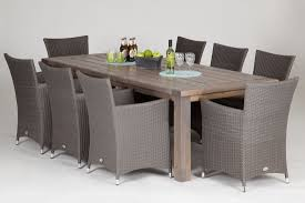 Wooden Table With  Rattan Chairs And A Free Cantilever Parasol - Dining table with rattan chairs