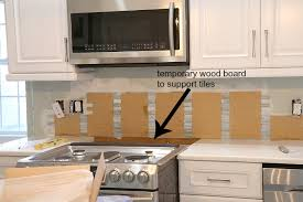 how to put up tile backsplash in kitchen installing a paper faced mosaic tile backsplash