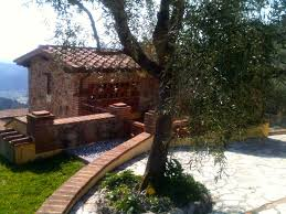 idyllic small farmhouse surrounded by olive and lemon trees
