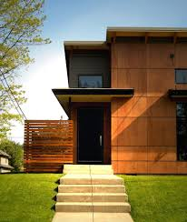 plywood house exterior industrial with wood rafters hand front doors