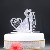 groom holding bride cake topper price comparison buy cheapest