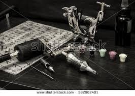 tattoo machine ink sketches on tattoo stock photo 582995041