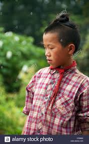southern man hair style young basha miao gun men boy with traditional hairstyle and red