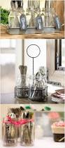 best 25 farmhouse flatware storage ideas on pinterest farmhouse display dinner essentials in vintage style with this mason jar caddy traditional clear glass jars are supported by a twisted metal stand
