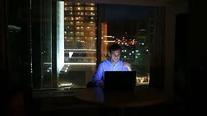 beautiful businessman working overtime at night in executive