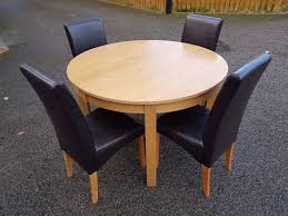 does round table deliver round oak veneer extending dining table 4 leather chairs free