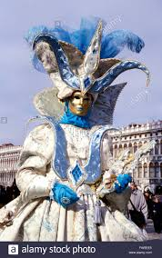 venice carnival woman in 17th century costume gold mask stock