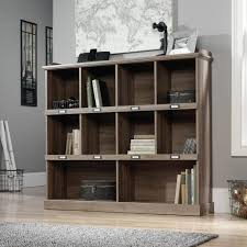living floating tv stand with shelf near black chair and small