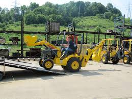 terramite u0027s t5x backhoe is a compact solution with a 8 foot 6