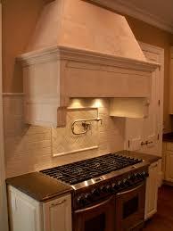 kitchen modern oven closed wooden cabinet and nice backsplash tile