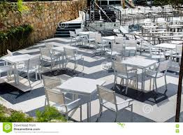 Restaurant Patio Tables by White Tables And Chairs Outdoor Restaurant Stock Photo Image