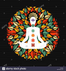 mandala made of tree leaves with body silhouette doing yoga lotus