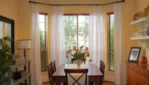 Bamboo Curtains For Windows Make Your Picture Windows Look Huge By Hanging Bamboo Blinds And