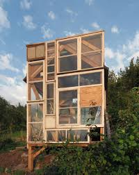 Modern Tiny Houses by A Tiny Garden House Built From Old Window Panes In Stuttgart