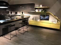 under cabinet kitchen lighting marble countertop and backsplash built in sink black stools casual