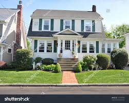 suburban colonial home front yard landscaped stock photo 121735786