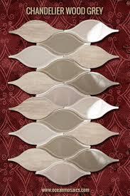29 best arabesque moroccan tile designs images on pinterest grey backsplash tile with natural stone and glass moroccan inspired arabesque backsplash chandelier wood