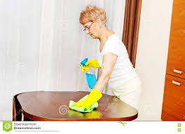 Cleaning Table Stock Images Royalty by Elderly Woman In Yellow Gloves Cleaning Table Stock Photo Image
