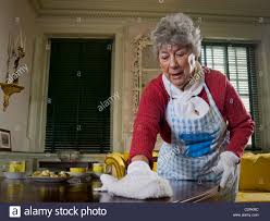 Cleaning Table Stock Images Royalty by Elderly Woman Cleaning Table In Historic House Philadelphia Usa
