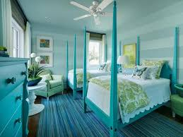 soft blue interior color with double four poster beds and striped