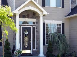 pictures of gray houses with colored doors the various