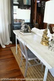 livingroom zones console table behind couch with chic stools