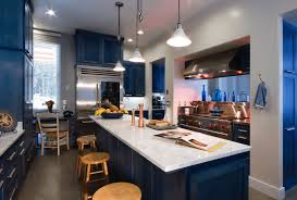 calming sleek kitchen design with dark blue cabinets and vibrant