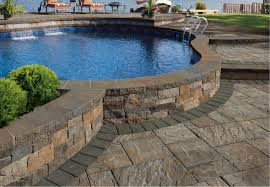 This Pool Is Surrounded By A Beautiful Patio Made With Cambridge U0027s