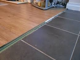 Can You Lay Tile Over Laminate Flooring Flooring How Can I Transition Between These Floors Home