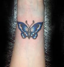 blue butterfly on wrist for tattooshunt com