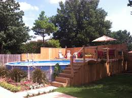 deck backyard ideas above ground pool but build a deck around it and it looks