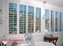 custom shutters in the bathroom can add privacy and elegance