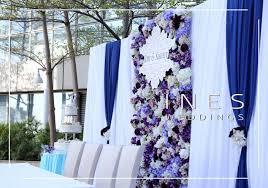 wedding backdrop blue poolside wedding purple and blue floral wedding backdrop design