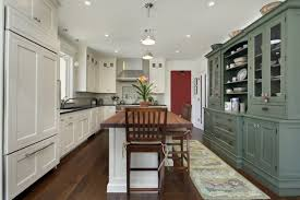 mix and match kitchen cabinet colors trend alert mixed cabinet finishes in the kitchen