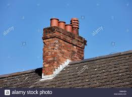 old victorian chimney stack with pots on the roof of a row of