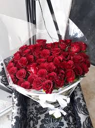 roses bouquet 100 roses bouquet wrapped including free delivery flowered