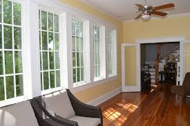 miami home design llc window interesting sunroom windows with brown wall and armchair
