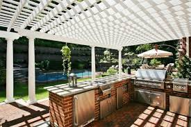 magnificent white color wooden pergola featuring red bricks