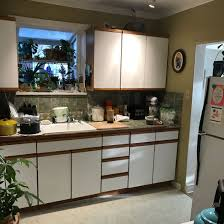 are brown kitchen cabinets outdated before and after small kitchen remodels