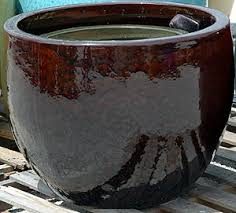 high gloss ceramic garden pottery and granite garden table and