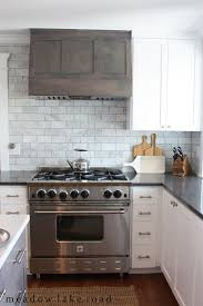 Rustic White Cabinets Tiles Backsplash Stainless Steel Gas Range Hood And White Subway