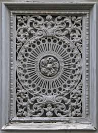 detail of gray ornament on building facade stock photo