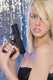 Stunningly by A Stunningly Beautiful Young Blond Woman Holding A Handgun Stock