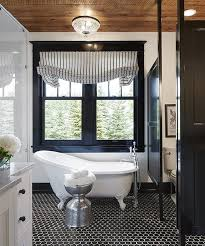 black casement windows wood ceiling black floor tile bathrooms