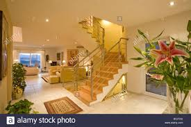first floor in spanish openplan living room and hall with staircase to first floor in