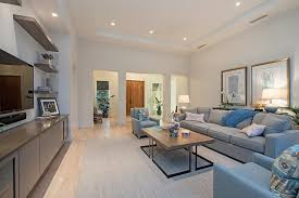 extra long sofas family room contemporary with art lighting beige