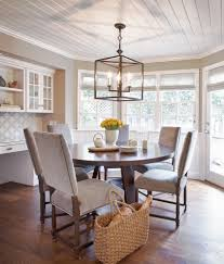 lantern light fixture with beadboard ceiling dining room